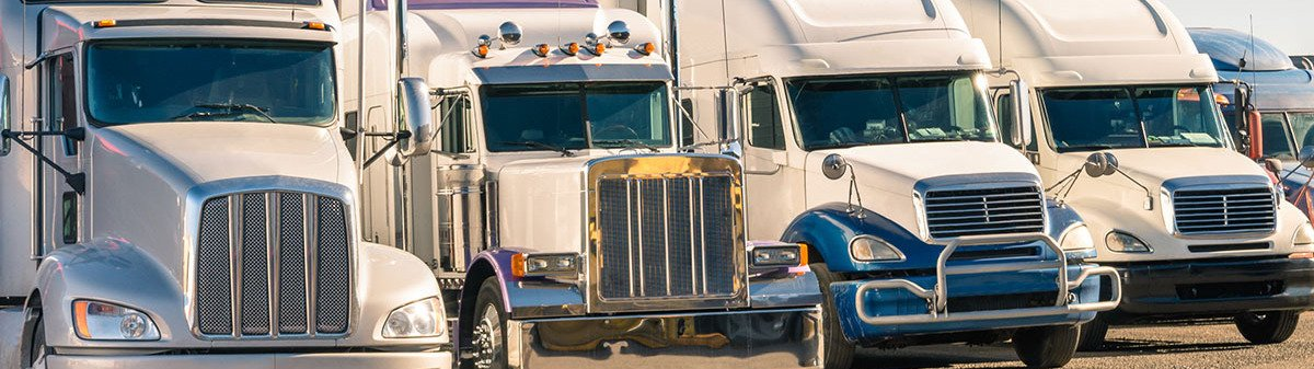 Front view of multiple semi trucks