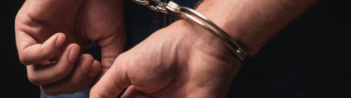 close up of hands in handcuffs