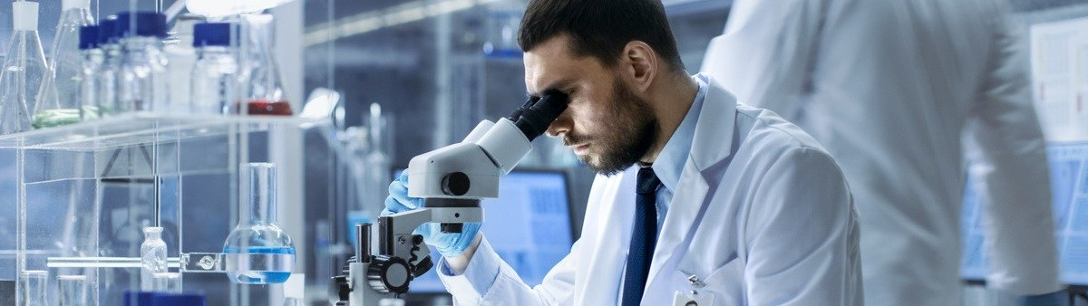 Man using microscope in lab