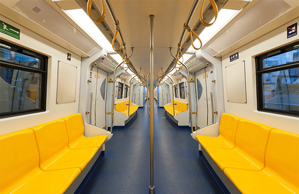 inside of train with yellow seats