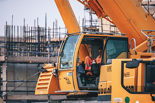 man operating construction truck