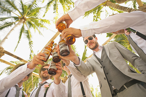 men toasting with beer bottles