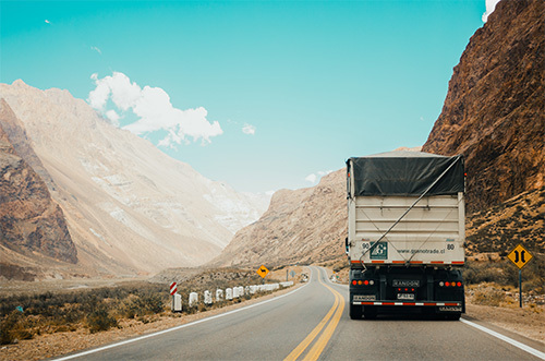 truck driving through the mountains