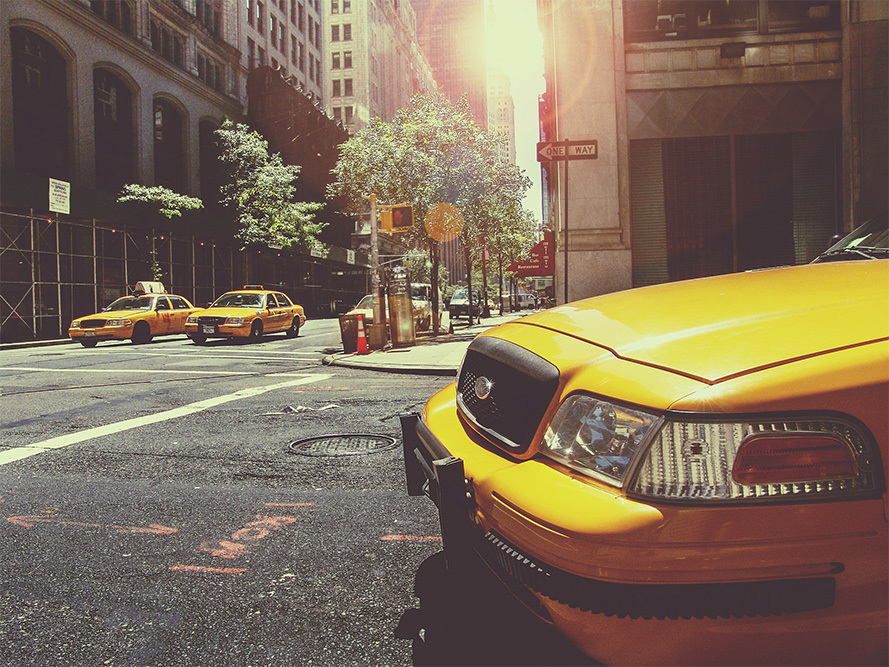yellow cab on the road